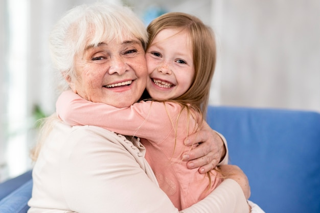 Grandma hugging girl