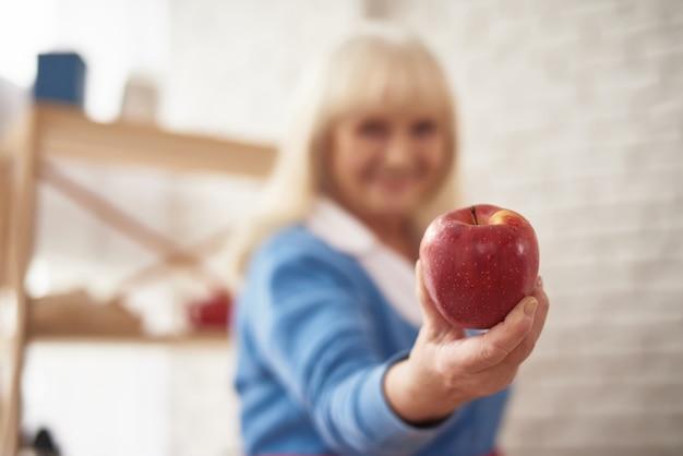 Grandma offers apple diabetic diet healthy food.