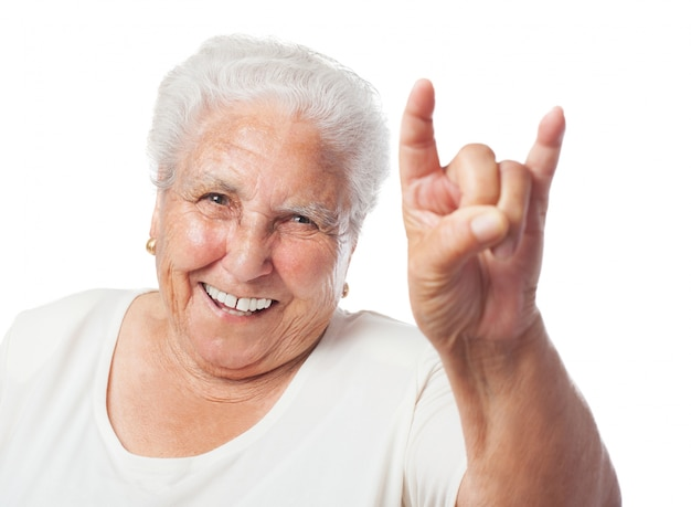 Grandmother doing the horns