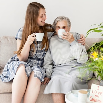 Grandmother enjoying coffee with granddaughter