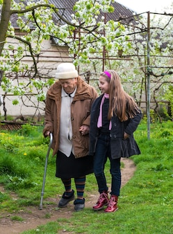 Grandmother and grandchild walking in the garden