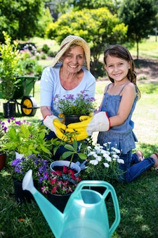 Grandmother and granddaughter gardening in the park