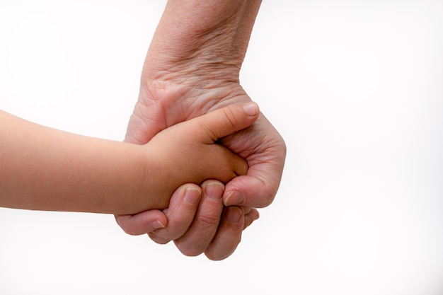 Grandmother and granddaughter hands on white background