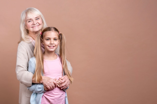 Grandmother and granddaughter with copy space background