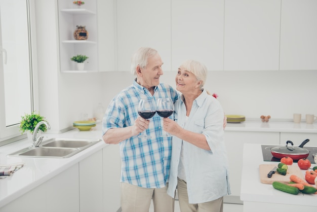 Grandmother grandfather people hold hand wineglass