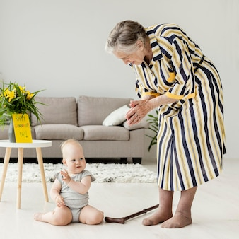 Grandmother playing with grandchild at home