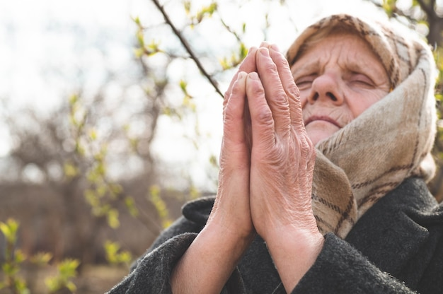 Grandmother pray for faith spirituality and religion. asking god for good luck, success, forgiveness