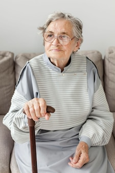Grandmother with eyeglasses at home