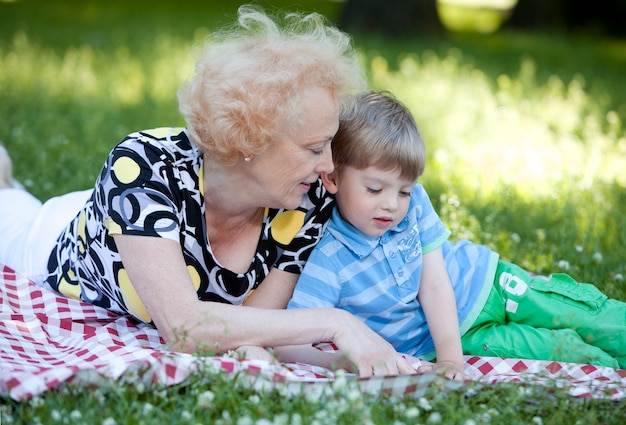 Grandmother with her grandson in the park