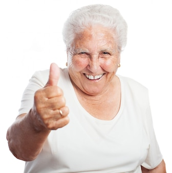 Grandmother with a raised thumb