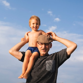 Grandpa holding grandson on shoulders