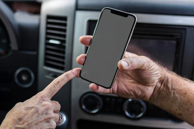 Grandpa showing his smartphone to grandma