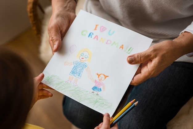 Grandparent holding drawing close up