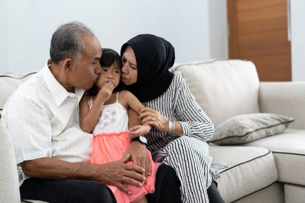 Grandparent kisses granddaughter on a chick