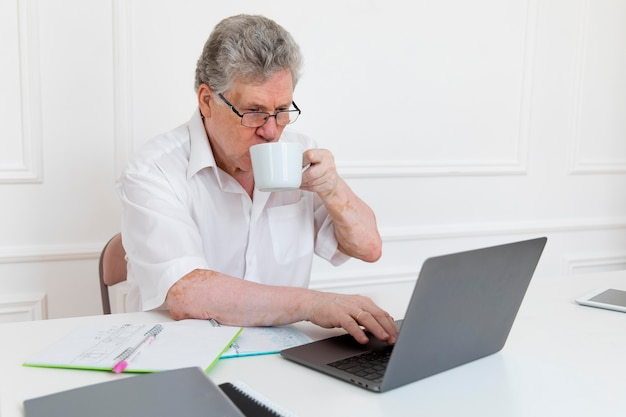Grandparent learning to use digital device