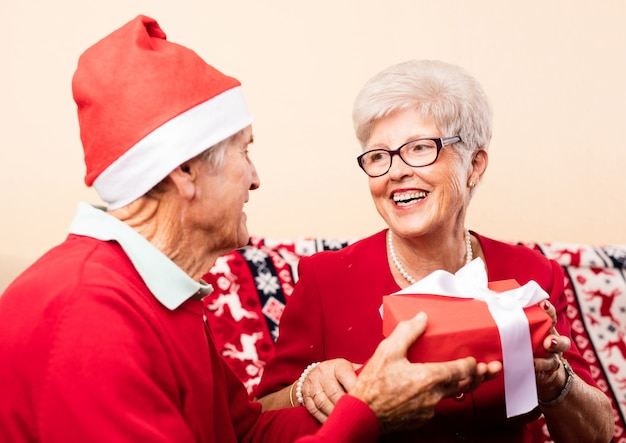 Grandparents giving presents each other