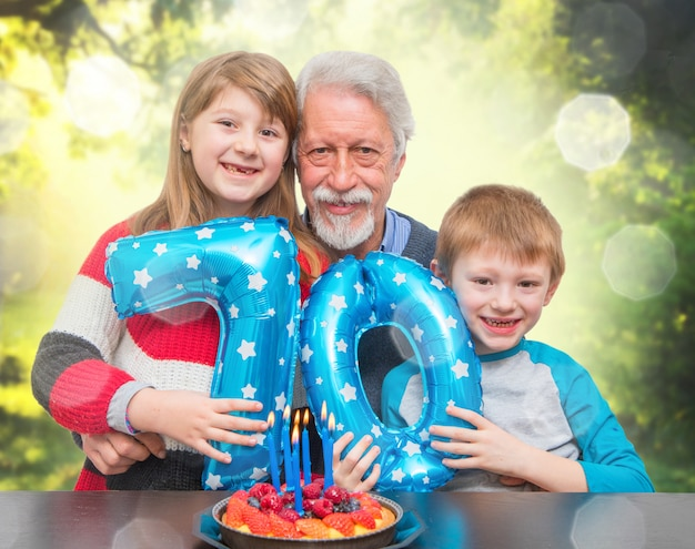 Grandson celebrating grandfather's birthday