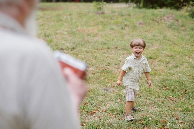 Grandson smiling for camera outdoor