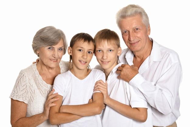 Внуки с бабушкой и дедушкой на белом фоне