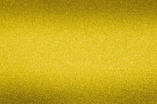 Granite background of golden color with small dots. darkening from the top and bottom.