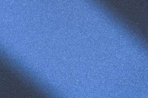 Granite background with blue color with small dots. darkening left and right diagonally.