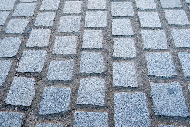 Granite cobblestoned pavement background full frame of regular square cobbles in rows