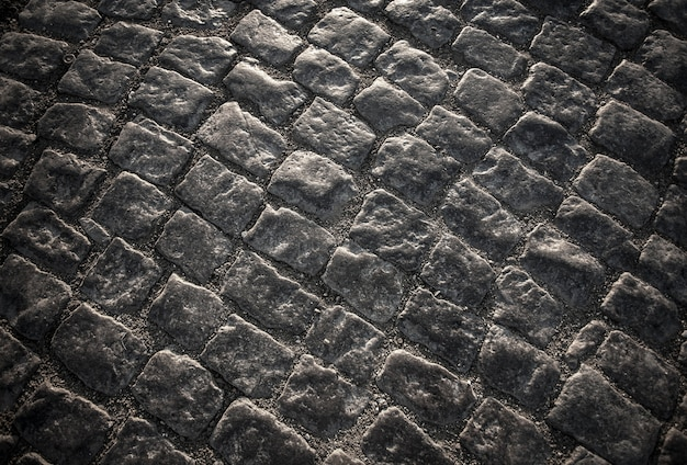 Granite cobblestones of block pavement