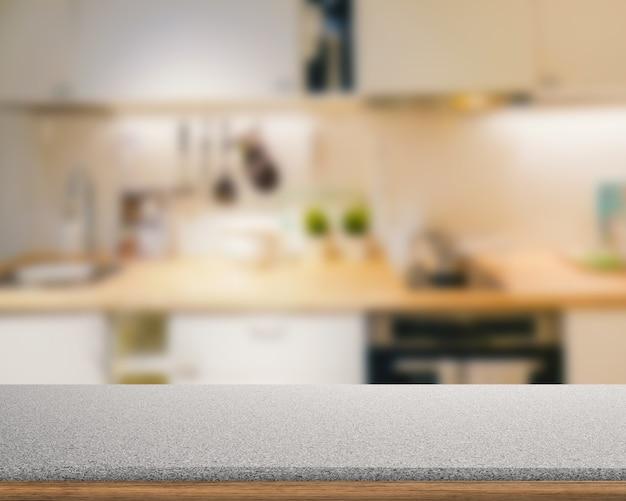 キッチンのぼやけた背景と花崗岩のカウンタートップ