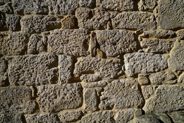 Granite stone bush hammered masonry wall