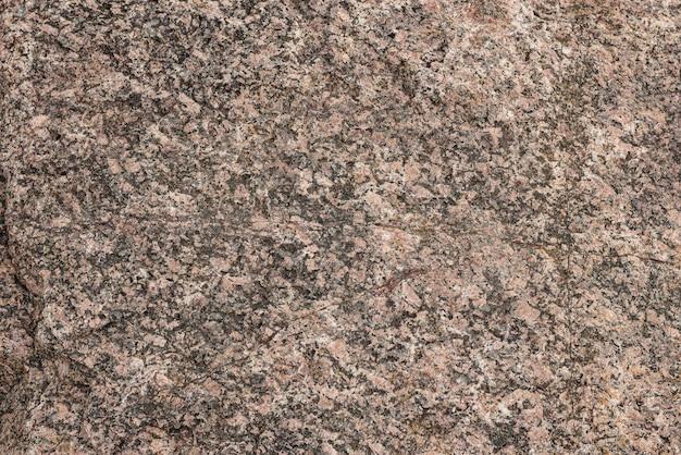 花崗岩の石の表面の質感。