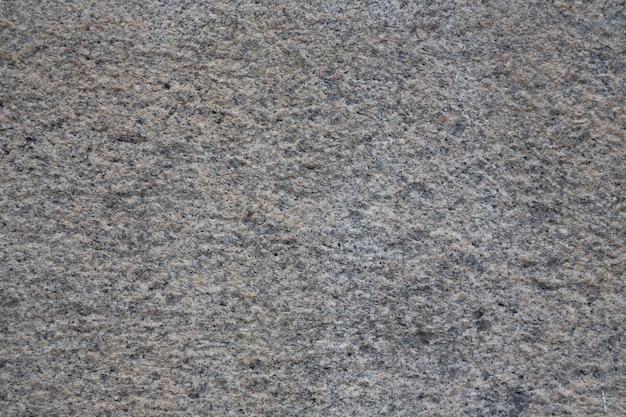Гранитная текстура, фон, гранитный камень, используемый для отделки зданий, столешниц, полов и других архитектурных идей.