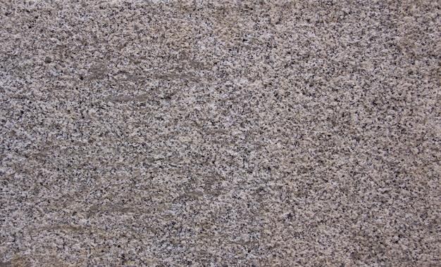 黒と白の色の花崗岩のテクスチャ。バックグラウンド。