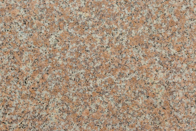 Granite texture of old wall of polished pink granite background
