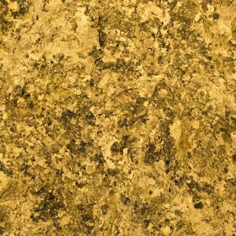 Granite texture, yellow, golden granite background, material for decorative texture, interior design.