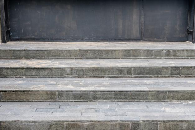 Granite tile floor stairway with black