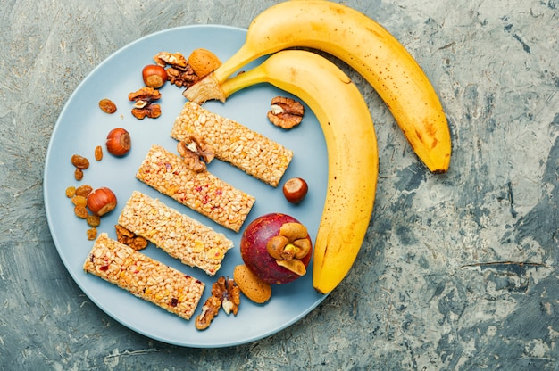 Granola bar and ingredients.homemade rustic granola bars with dried fruits and nuts