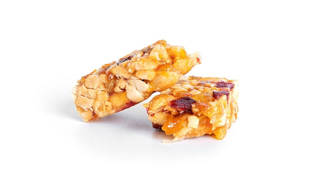 Granola bar with nuts and dried fruits isolated on a white background. high quality photo