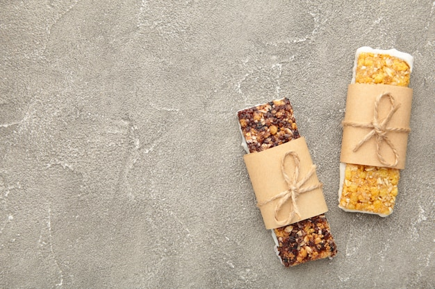 Granola bars on grey with copy space. diet and breakfast