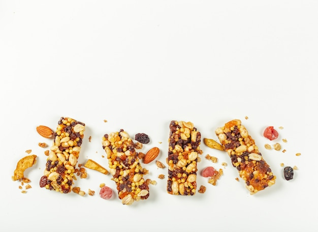 Granola bars isolated on white surface.