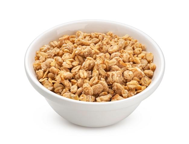 Granola, bowl of crunchy muesli isolated on white background