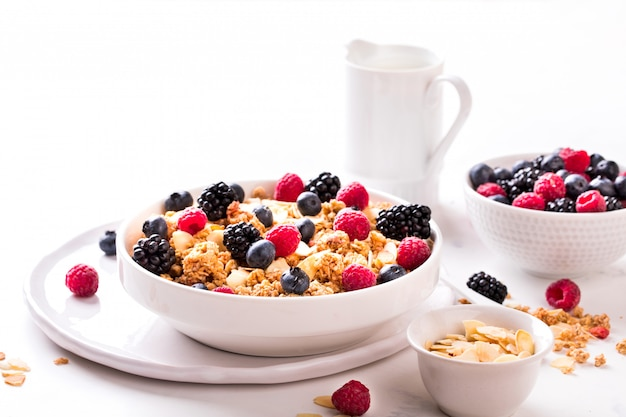 Granola cereal with berries and milk