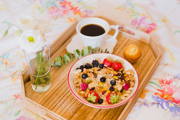 Granola and coffee for breakfast in bed