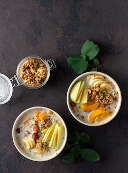 Granola fruit with milk peanut butter in bowl