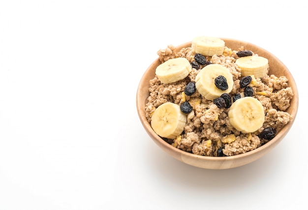 Granola with banana, raisin and milk for breakfast