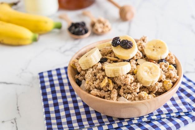 Granola with banana, raisin and milk
