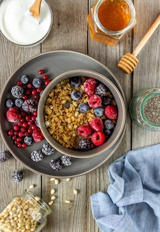 Granola with berries, yoghurt and honey.
