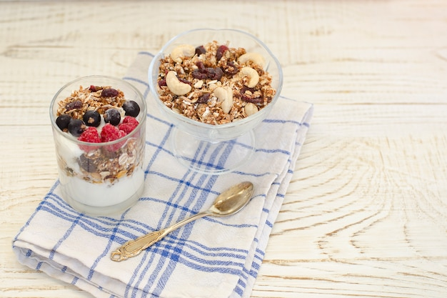 Granola with berries and yogurt on a wooden table. traditional american breakfast