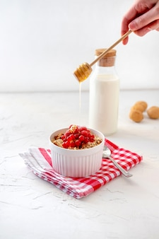 Granola with fresh berry and milk