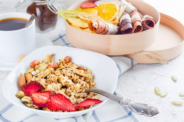 Granola  with fruit, chips and coffee