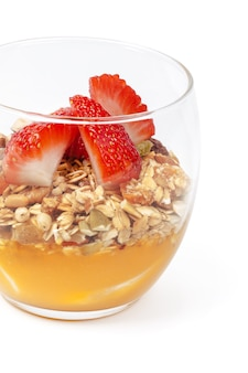 Granola with jam and strawberries isolated on white background